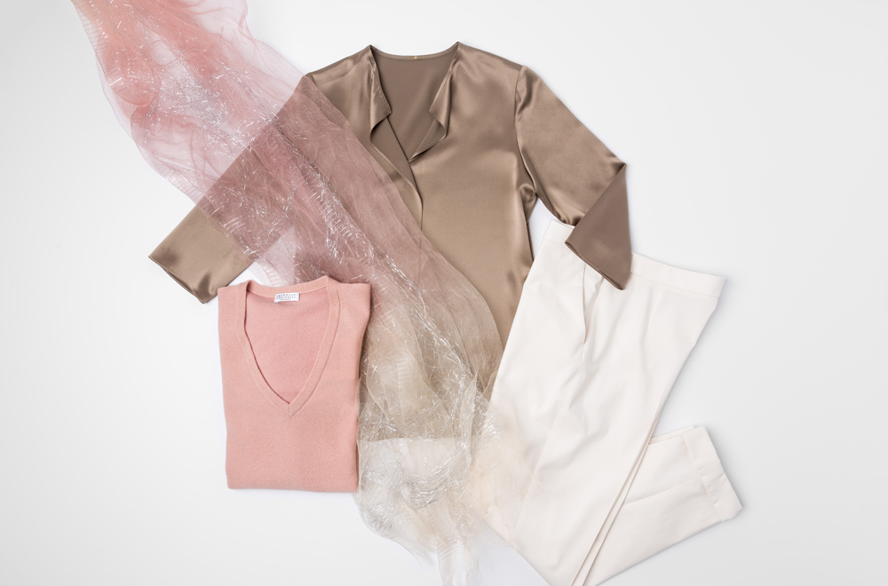 Peter Cohen gold silk shirt, Brunello Cucinelli pink v-neck sweater, Faliero Sarti sheer peach scarf, and Akris white pants | Santa Fe Dry Goods & Workshop