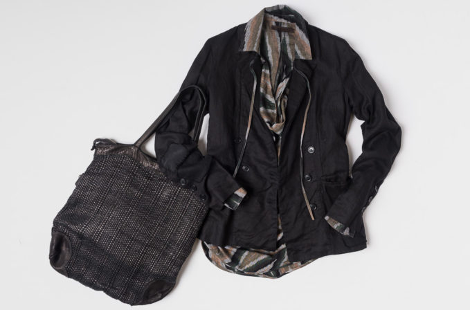 Greg Lauren black jacket, Nicholas K Ikat shirt, and Vive La Difference black leather handbag