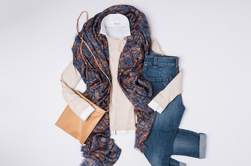 The Row Margi Cashmere/silk Sweater in Cream, The Row Brown Leather Handbag, Brunello Cucinelli white shirt, Brunello Cucinelli denim jeans, and Alonpi Cashmere Scarf | Santa Fe Dry Goods & Workshop