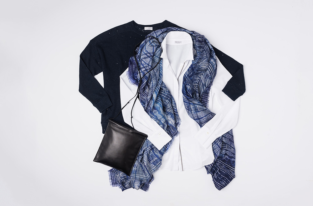 Brunello Cucinelli Navy Blue Sweater and White Button Up shirt, Alonpi Cashmere blue scarf, and The Row black leather handbag | Santa Fe Dry Goods
